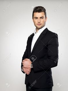 Fashion Young Businessman Black Suit Casual Poses At Studio Stock Photo, Picture And Royalty Free Image. Image 17853427.