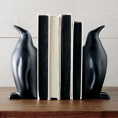 Proud penguins team up in black powdercoated aluminum to prop up books and look great on any bookcase.