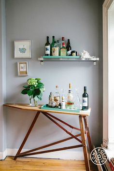 Bar carts make hosting in small spaces easy and keep everything in one place for those last-minute get togethers. Also, you don't even have to use a real bar cart. Break out that ironing board you never use! #etsy #homepolish