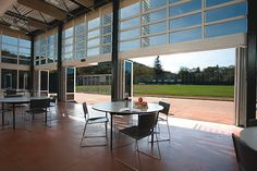 Sir Francis Drake High School--NanaWall folding glass wall systems blurring the lines between indoor and outdoor spaces. Nana Wall, Modern Glass House, Glass Wall Systems, Movable Walls, Glass Building, Glass Office, Washing Windows, Glass Partition, Sliding Glass Door