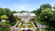 Inside a $55 Million Compound on Long Island's Gold Coast – Robb Report Long Island, Three Bridges, Lake Hotel, Gatsby Themed Party, Custom Fireplace, Wolf Of Wall Street, Mansions For Sale, Outdoor Swimming Pool, Water Slides