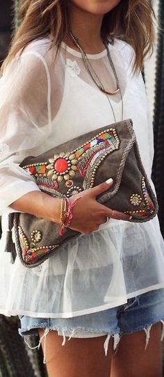 Sheer blouse and boho jeweled purse.