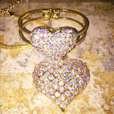 Rhinestone heart necklace and cuff The beautiful jewelry set you are looking at it is a heart necklace and heart cuff. The chain on the necklace is short and the cuff fits small . Beautiful for any formal occasion. Jewelry Necklaces