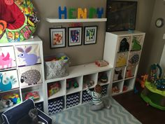 Baby nursery toddler play room. Three IKEA cube shelves Kallax with 3 Sprout animal and blue chevron bins for storing toys. Finger paint artwork framed and Mega Bloks spell out Henry. Perfect for him to play in as a baby and as a big kid.