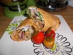 A simple, healthy wrap sandwich filled with garbanzo beans cooked in a savory spice blend, Greek yogurt, capers and romaine lettuce.