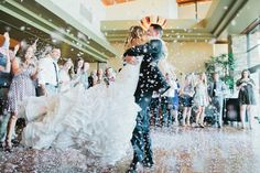 Trilogy at Vistancia Weddings | Creative idea: Have your guests through feathers or confetti around the bride and groom! Makes for a great photo op | www.weddingsatvistancia.com | Andrew & Jade Photography