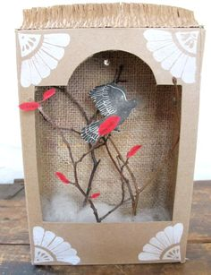 I might do something like this, but a little more upscale. Maybe a wooden box with red bird!