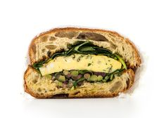 Frittata Sandwich with Olive Salad Recipe. Lettuce and tomatoes might be classic sandwich stuff, but this herby olive salad brings way more to the table—and it will never wilt. Arugula Recipes, Slaw Recipes, Egg Recipes, Frittata, Olive Salad, Vegetarian Recipes, Cooking Recipes, Food Porn, Olive Recipes