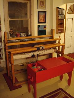 "Loom set up for weaving: ""It does take up a fair amount of space in the living room, but definitely not the entire floor."" emmajanehw. I love love love this room and loom and especially the red weaver's bench! (Right now I am trying to figure out how to bring a 45"" counterbalance loom into my 475 sq foot apartment. This is very inspiring. Oh well, I'd rather have a studio than a living room anyway! ~RB)"