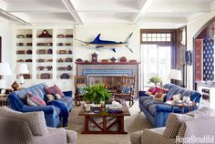 Lake Michigan house room fireplace, decorated with kaleidoscopic Moroccan tile from Urban Archaeology. Designer Martin Horner of Soucie Horner upholstered the sofas in not one, but two fabrics — Dedar's Sottosopra on the frame and Bergamo's Ucria on the cushions. Throw pillows made out of vintage textiles by Lynda O'Connor add more color. C&C Milano's Pienza Rafano covers the club chairs. Rug by Oscar Isberian.