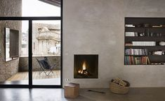 LOVE the bookshelf and fireplace. And the patio. The whole thing really.