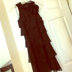 Ruffled black cocktail dress. Ruffled black cocktail dress. Bottom hits right around knees/slightly below. Size 0, however, runs big. I am size 4 and it fits comfortably. Great dress for date night/special occasion. *Like new- only worn once by me!!* White House Black Market Dresses Midi