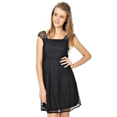 Vila dress with structure. Sewn waist ribbon. Light lining. The length is 84 cm. Small in size. Fabric: 100% polyester. Lining is 100% polyester. Model: 14012158 Tegan Dress E
