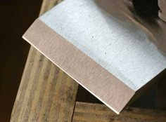 """A curved cutting edge is critical to most operations with your bench planes. The curve prevents the corners of the iron from digging into your work, and it allows you to correct the flatness of the face or edge of a board. But how do you create this curve, sometimes called a """"camber?"""" And how do you create it with a honing guide, which seems to encourage a cutter that …"""