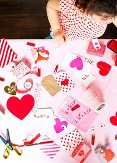 Host your very own Valentine's Day craft party! Grab some ribbon, glitter & other supplies & have some fun. 'Colorful favor bags w/ fun prints make great crafting paper!'