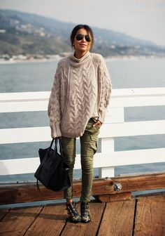 Oversized sweater and olive moto pants