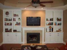 Fireplace Remodel - custom built ins  Add glass doors and expose top shelf?