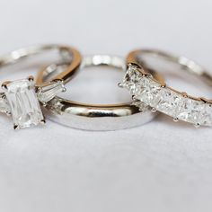 Cushion diamond three-stone ring with sidestone trapezoidal baguettes | Princess diamond five stone ring | Platinum setting | Photo by www..anouschkarokebrand.com
