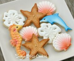 Beautiful seashore cookies, accented with airbrushing, by Sugarbliss, via Sweet Adventures of Sugarbelle.