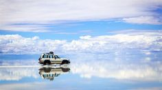 In This Remote Corner of South America, It's Possible to Walk on the Sky -- Believe it or not, it isn't magic. It's Salar de Uyuni: the world's largest salt flat, spanning more than miles in southwest Bolivia. Top Destinations, Caribbean Sea, Filming Locations, Science And Nature, Natural Wonders, Tour, South America, Places To See, Beautiful Places