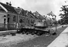 A Russian JS-2 heavy tank destroyed in the Czech town of Znojmo. Looks like it was being used to block a possible roadway....