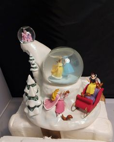 """Disney Store Princess Skating Snowglobe Belle Snow White Cinderella Beauty RARE     This is a deluxe model, it is retires    This does not have the rod or key to play music, they can be purchased separately**    No chips or cracks    8"""" tall X 10"""" High    Disney Store exclusive    Please inspect photos for more information     Thanks and be sure to check out all our other collectibles for sale 
