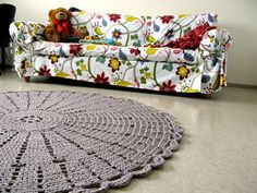 crochet rug idea....but look at the sofa slipcover!  ♥ it!