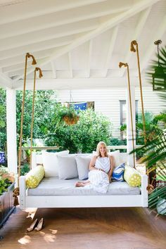 this porch swing was all DIY!!!! the swing was built and the cushions were made (it's actually a twin mattress!) LOOOOVE this project and will oneday try to duplicate it!! Porch Swing Makeover With GDC - Look Linger Love