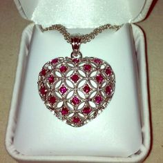 """Ruby Heart Pendent with Chain 1 Carat Total Gem Weight Created Ruby Heart Pendant With Chain.  Pendent is 1"""" and chain is 18"""" long.  New and never worn.  Includes white jewelry box (as seen in pic) for gift giving. Jewelry"""