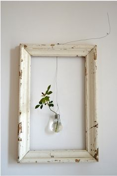 - empty frame with suspended lightbulbvase plus leaves - Orietta Marcon of Vicenze-based design studio Civico Quattro in a loft in italy. inspired living room A Rustic Loft in Italy, from a Rising Design Star - Remodelista Loft Design, House Design, Design Design, Design Studio, Floral Design, Cuadros Diy, Diy Home Decor, Room Decor, Diy Wall Decor