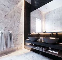 Beautiful use of marble and stone in this master bathroom. Double sink unit with shelf and backlit mirror.