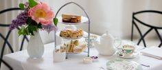 Afternoon Tea 12.00-18.00 English Orangery Afternoon Tea Egg mayonnaise and cress bridge roll, smoked salmon and cream cheese mini bagel, Coronation chicke