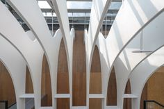 Image 11 of 23 from gallery of Rain of Light / Yuan Architects. Photograph by Max Lee City Select, Light Well, Taipei Taiwan, White Paneling, Retail Design, White Wood, Rain, Stairs, Architects