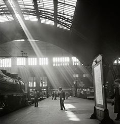 """AP Photo/International Center of Photography, United States Holocaust Memorial Museum, Roman Vishniac : """"Sunlight streams into a Berlin railway station, late 1920s to early 1930s."""""""