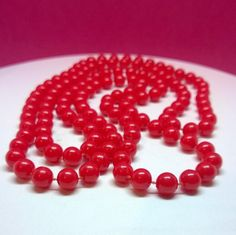 Vintage / Retro style long costume necklace with small plastic red beads by ThePemburyEmporium on Etsy