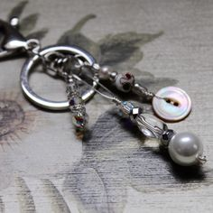 Antique button keychain/bagclip combo in silver! Perfect gift for any classy for woman on your gift list. Elegant and functional - she will see it every day! Made with a lovely antique mother of pearl button, Swarovski crystals, upcycled pearls and more!