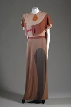 "Evening Gown, Gilbert Adrian (1903-1959), USA: 1938, silk crepe. ""Gilbert Adrian was best known for his Hollywood film costumes, yet he also designed fashionable clothing that was often influenced by modern art. This dress, for example, constructed from many different pieces, demonstrates the influence of Cubism."""