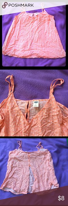 Pink pineapple tank Pink and white tank with adjustable straps. Has pineapples on the pattern, very tropical. Is a light pink/peach color. The back has 4 buttons and then is backless. Great for spring break!! Shirt is slightly wrinkled from being folded with my poshmark stuff but ca be steamed. Make an offer! Says size is medium but I would say it is on the larger side Old Navy Tops Blouses
