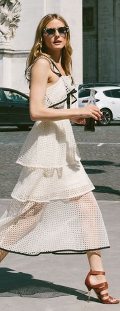 Who made  Olivia Palermo's cat sunglasses and white lace dress?