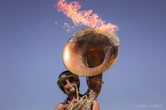 The Flaming Tuba Guy performing at the French Quarter at Burning Man 2015. (Photo by Scott London)