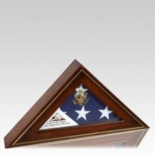 The Five Star General Flag Display Case is assembled by hand. This two piece unit encases the flag entirely. The front piece holds the flag and slides into the back portion for the most dust free environment possible. This flag case is designed to display the American Burial Flag and features a hand distressed finish with a hand applied gold trim.