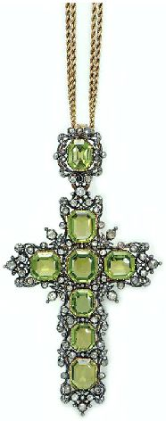 AN ANTIQUE PERIDOT AND DIAMOND PENDANT BROOCH  Designed as a rectangular-cut peridot cross, with a rose-cut diamond openwork foliate border, suspended by a similarly-set bail, to a twin gold ropework chain, mounted in silver-topped gold, the pendant circa 1880, 25½ ins., with maker's marks (2)
