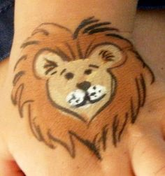 I think this one is the best lion. Tan, brown, a little white, and outline in black. #facepaintingideas