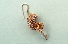 Dutch treat earrings.  Find more projects on BeadAndButton.com