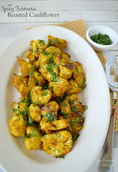 Get the health benefits of turmeric and a delicious side dish with this easy roasted cauliflower recipe: http://anoregoncottage.com/spicy-turmeric-roasted-cauliflower/