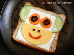 Monkey Sandwich.  Bread, cheese , carrot, cucumber , olives , egg & tomato sauce