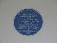 Blue plaque outside of The Holy Trinity Church, Clapham Common, which opened in 1776. This is where William Wilberforce and the Clapham Set used to meet to discuss the abolition of the slave trade.