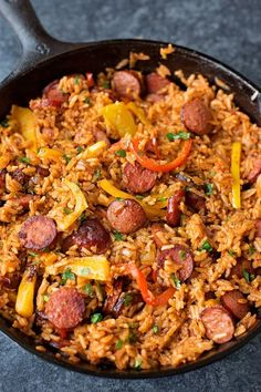Smoky kielbasa sizzled with sweet bell pepper, onions and garlic in vibrant tomato sauce. This quick and easy sausage, pepper and rice skillet is downright delicious! food recipes Sausage, Pepper and Rice Skillet Pork Recipes, Cooking Recipes, Healthy Recipes, Cooking Cake, Budget Recipes, Quick Food Recipes, Healthy Meals, Healthy Food, Meat Recipes