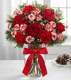 Red roses, red carnations, peppermint red and white mini carnations arranged in a glass vase with christmas decorative greens. Valentine Flower Arrangements, Valentines Flowers, Christmas Arrangements, Beautiful Flower Arrangements, Floral Arrangements, Beautiful Flowers, Christmas Decorations, Christmas Tables, Valentine Nails