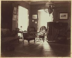"""[Corner of drawing room, facing south and west, Dom Smith, Vladivostok, Russia] Summary Interior view shows large windows, furniture, and decorative items arranged in the drawing room. The companion view is no. 5. In a letter dated May 26, 1900, Eleanor Pray wrote: """"I toned my photos because I want to get some off to you on this mail. ... Those of the drawing-room are wretched and I only printed those two, but I thought you would be interested in them so I send them along with the others."""""""